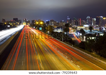 Long exposure of freeway and city skyline of San Diego, California - stock photo