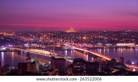 Long exposure of golden horn with mosque skyline in Istanbul at night, pink colors - stock photo