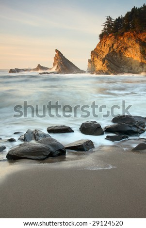 Long exposure of incoming waves at Sunset Bay on the Oregon coast. - stock photo