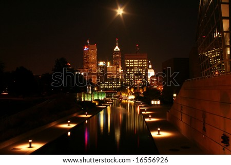 Long exposure of Indianapolis skyline at night under full moon - stock photo