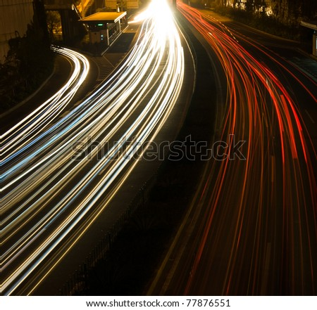 Long exposure of night time rush hour. - stock photo