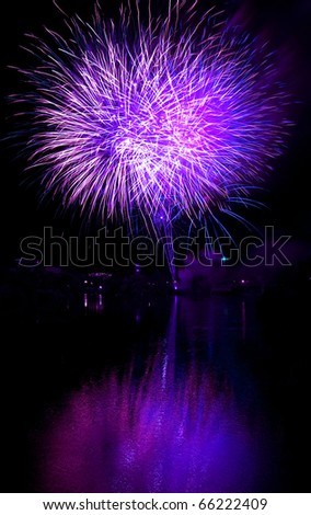 Long Exposure of Purple Fireworks Against a Black Sky - stock photo