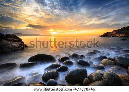 Long exposure of sea and stones, beautiful sunrise in Quy Nhon city, Vietnam