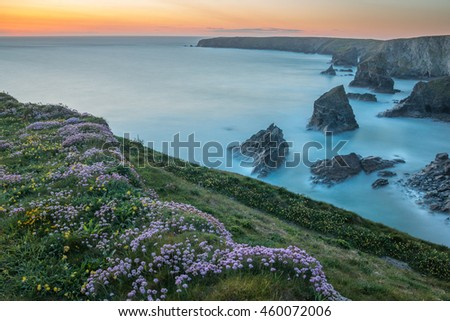 Long exposure of sunset at Bedruthan Steps with thrift