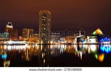 Long exposure of the Baltimore Skyline and Inner Harbor at night. - stock photo