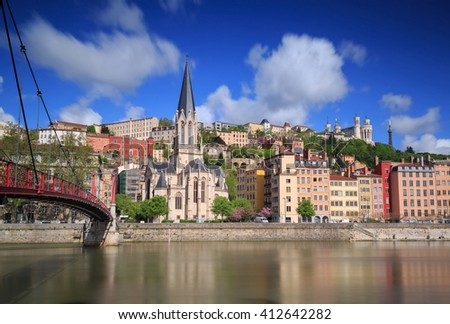 Long exposure of the church of Saint Georges and footbridge Passerelle Saint-Geroges in Lyon, France. - stock photo