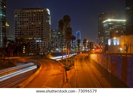 Long exposure of the evening rush hour in downtown Los Angeles, California. - stock photo