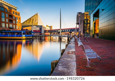 Long exposure of the Waterfront Promenade and the National Aquarium in Baltimore, Maryland. - stock photo