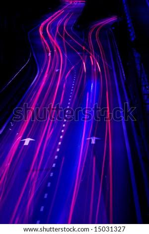 Long exposure of urban night traffics in dusk - stock photo