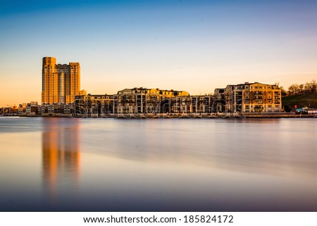 Long exposure of waterfront condominiums at the Inner Harbor in Baltimore, Maryland. - stock photo
