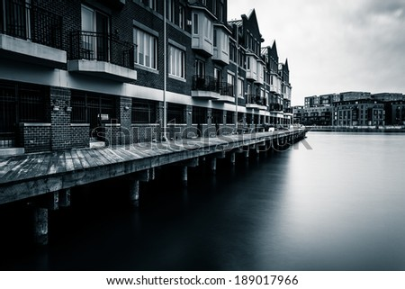 Long exposure of waterfront condominiums in Fells Point, Baltimore, Maryland. - stock photo