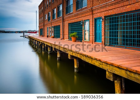 Long exposure of waterfront residences in Fells Point, Baltimore, Maryland. - stock photo