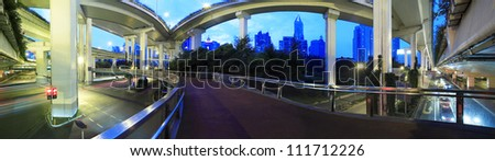 Long exposure panoramic photo High-speed urban viaduct construction background at night - stock photo