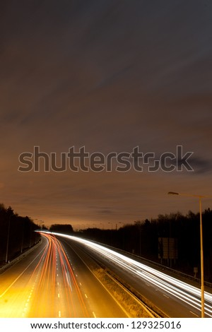 Long exposure photo of traffic - stock photo