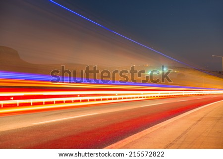 Long exposure photo of traffic on the move  - stock photo