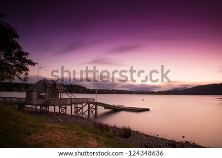 Long exposure photograph of beautiful view of lake at Te Anau in sunset time, South Island, New Zealand - stock photo