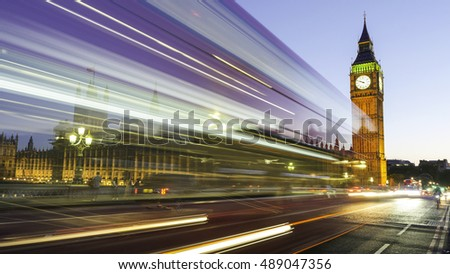 Long exposure picture of the Big Ben and Westminster in London at night with bus and traffic light trails