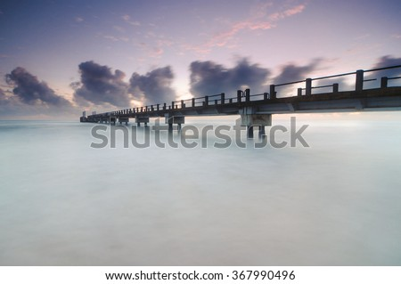 long exposure shot during sunrise at ''Star Cruise Kijal Jetty'' . soft focus due to long exposure. - stock photo