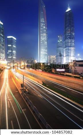 Long exposure shot of Background night view of Shanghai city landmark buildings - stock photo