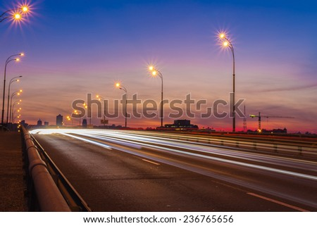 Long exposure shot of bridge vehicle evening scene
