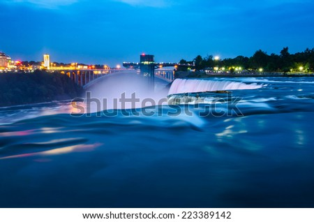 Long exposure shot of Niagara Falls in the evening of summer from USA side./Niagara Falls Night Scene from United States side - stock photo