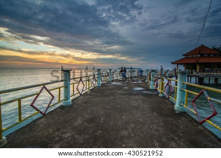 Long Exposure Sunrise Seascape with Abandon Jetty. Soft Focus, Motion Blur Due to Long Exposure Shot. Copy Space Area - stock photo