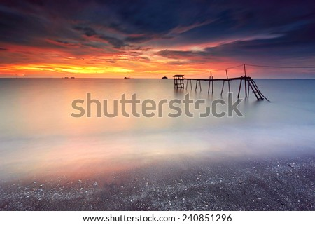 Long Exposure Sunset at Jeram Beach, Malaysia - stock photo