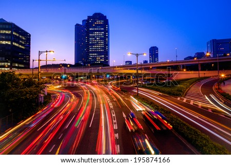 Long exposure traffic scene of tokyo - stock photo
