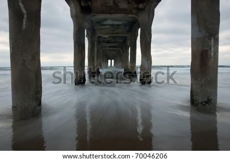 Long exposure underneath the Manhattan Beach Pier in Los Angeles, California. - stock photo