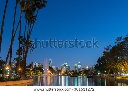 Long exposure view of Los Angeles downtown at night from Echo Park Lake - stock photo