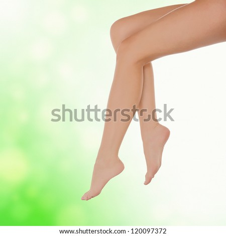 Long female legs after depilation, abstract blurred background - stock photo
