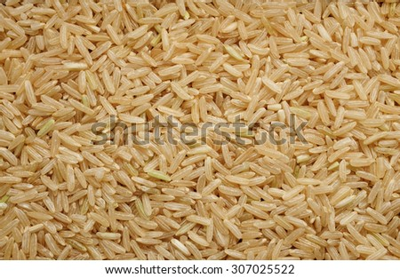 Long grain brown rice as an abstract background texture - stock photo