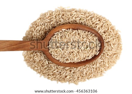 Long grain brown rice on wooden spoon. Isolated on white background. Directly Above.