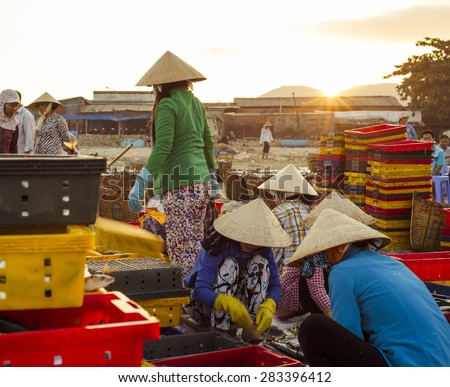 Long Hai, Ba Ria - Vung Tau Province, Vietnam - 31 May 2015: A group of local people doing daily's work at Phuoc Hai Fish Market, Long Hai, Ba Ria - Vung Tau province, Vietnam