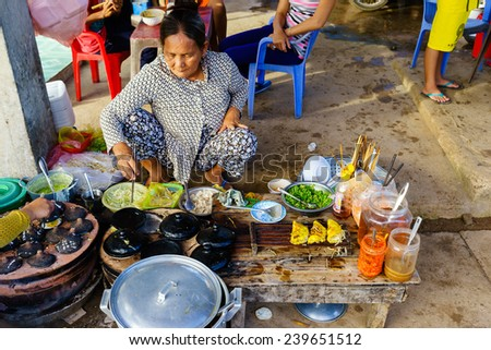 LONG HAI, VUNG TAU, VIETNAM - DEC 21, 2014. Vietnamese fast food (Banh Xeo) vendors at Long Hai fish market on early morning. The local market only happens in early morning. - stock photo