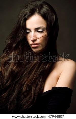long hair brunette woman studio portrait - stock photo