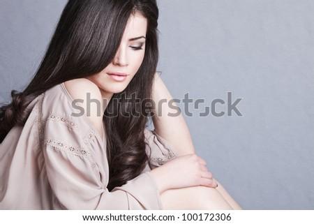 long  hair brunette woman studio shot - stock photo