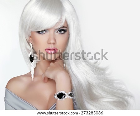 Long hair. Fashion Blond girl with white wavy hairstyle. Expensive Jewelry.Beauty portrait. Attractive woman model posing on studio background.  - stock photo