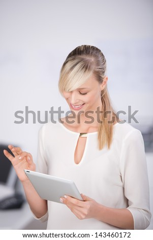 Long hair female browsing the internet through digital tablet - stock photo