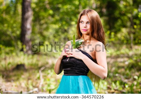 Long - hair girl forest portrait with may-lily. - stock photo