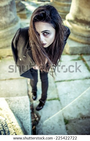 Long hair girl with scary makeup - stock photo