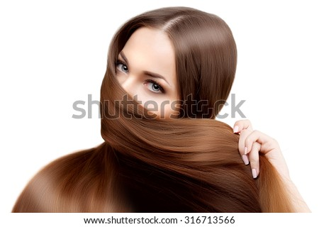 Long hair. Hairstyle. Hair Salon. Fashion model with shiny hair. Woman with healthy hair girl with luxurious haircut. Hair loss. Concept of oriental woman, face covered by hair - stock photo