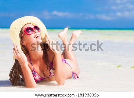 long haired girl in bikini and sunglasses on tropical Boracay beach - stock photo