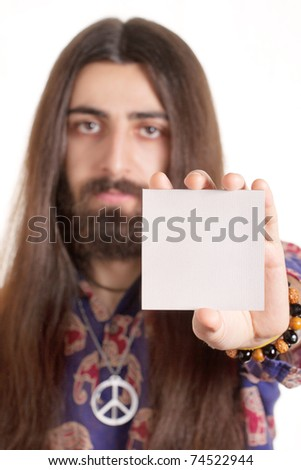Long-haired hippy man holding blank paper card
