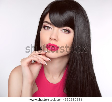 Long healthy Hair. Makeup. Manicured nails. Beautiful model girl with black straight shiny hair and sensual lips isolated on studio background. Beauty Brunette Woman.  - stock photo
