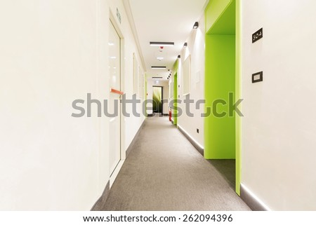 Long hotel corridor - stock photo