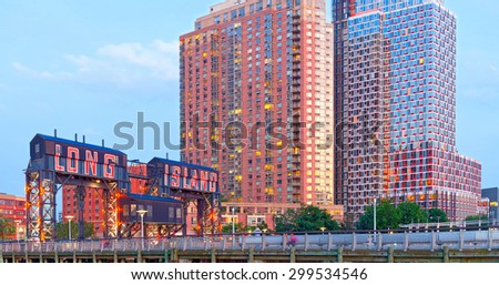 Long Island City New York, sign and modern architecture in Gantry Plaza Park Queens - stock photo
