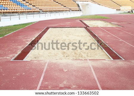 long jump pit in sports stadium - stock photo