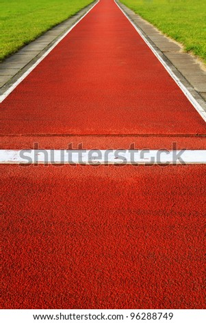 Long jump track in a sports and athletics stadium - stock photo