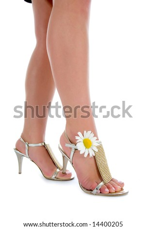 long legs on high heels with flowers on white